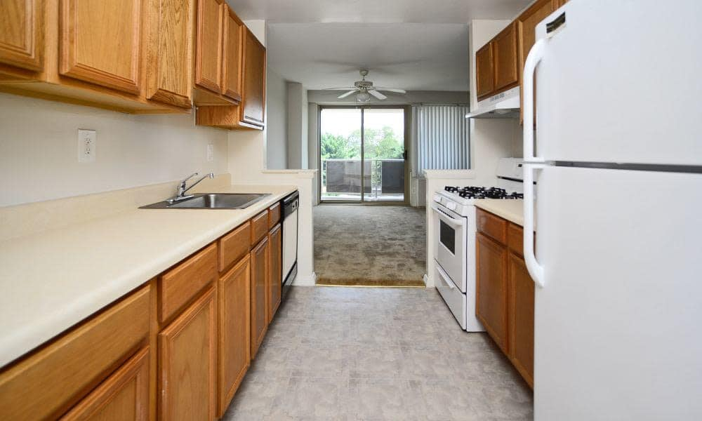 Plenty of cabinet space in the kitchen at Towers of Windsor Park Apartment Homes in Cherry Hill, NJ