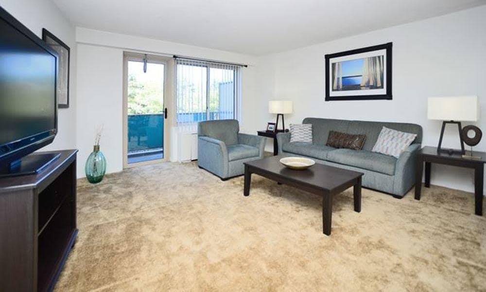 Well decorated model living room at Towers of Windsor Park Apartment Homes in Cherry Hill, NJ