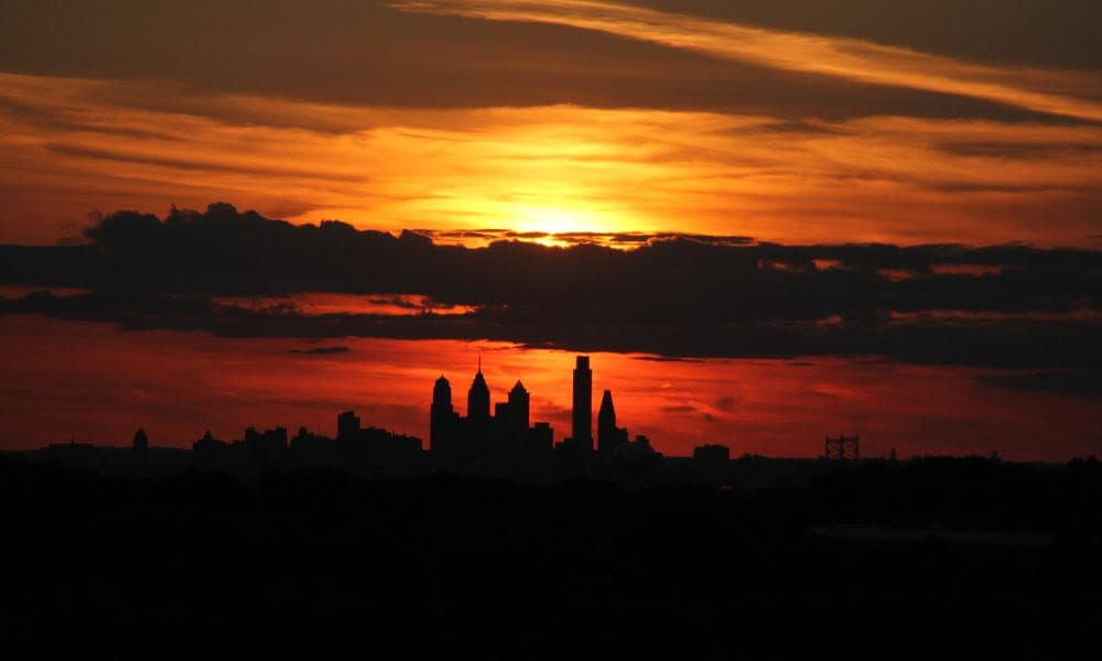 Setting sun above the city skyline in Cherry Hill, NJ