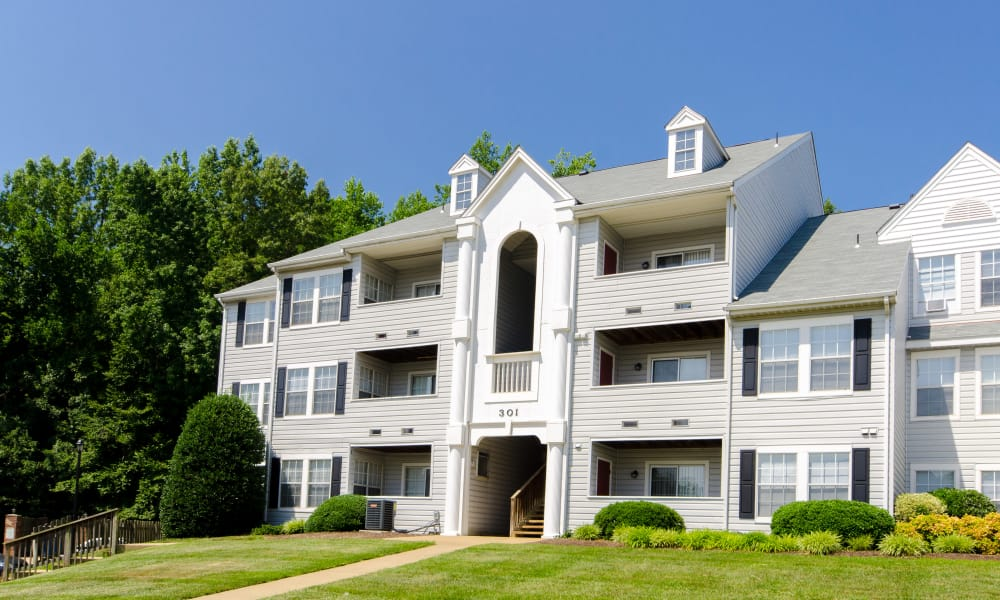 Stunning exterior view of apartments at The Pointe at Stafford Apartment Homes in Stafford, VA