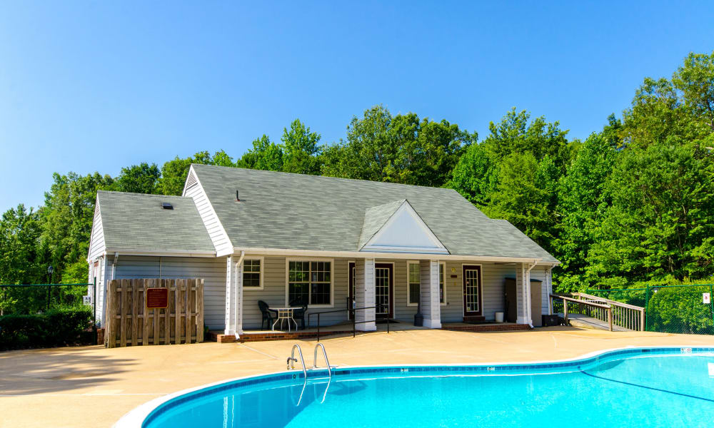 View of pool and leasing office at The Pointe at Stafford Apartment Homes in Stafford, VA