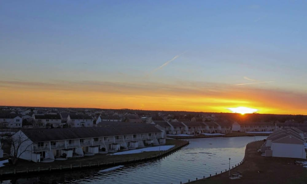 Sunset over the cove at Mariners Cove Apartment Homes in Toms River, NJ