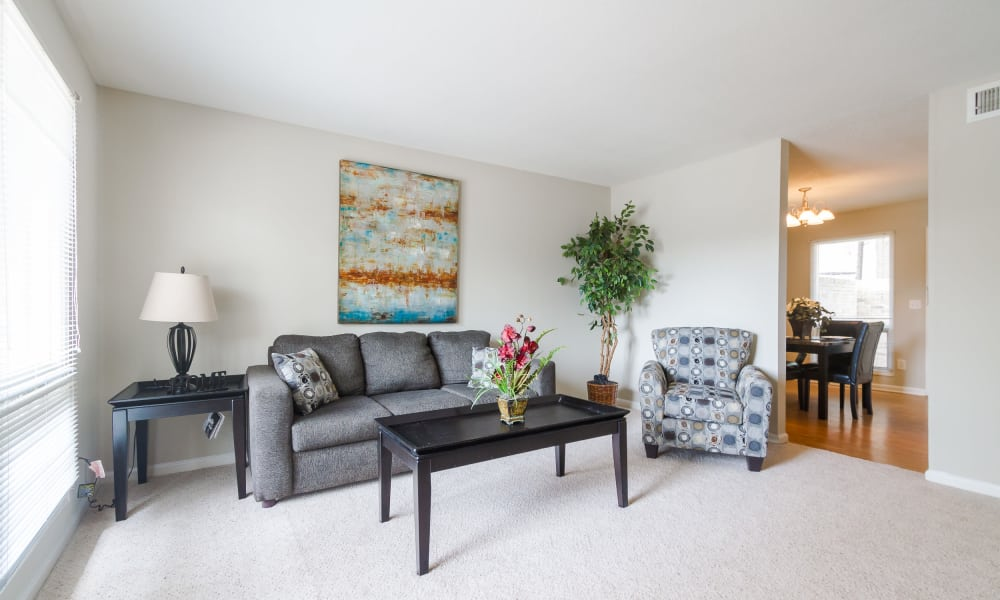 Bright living room at Castlegate Windsor Park Apartments in Columbus