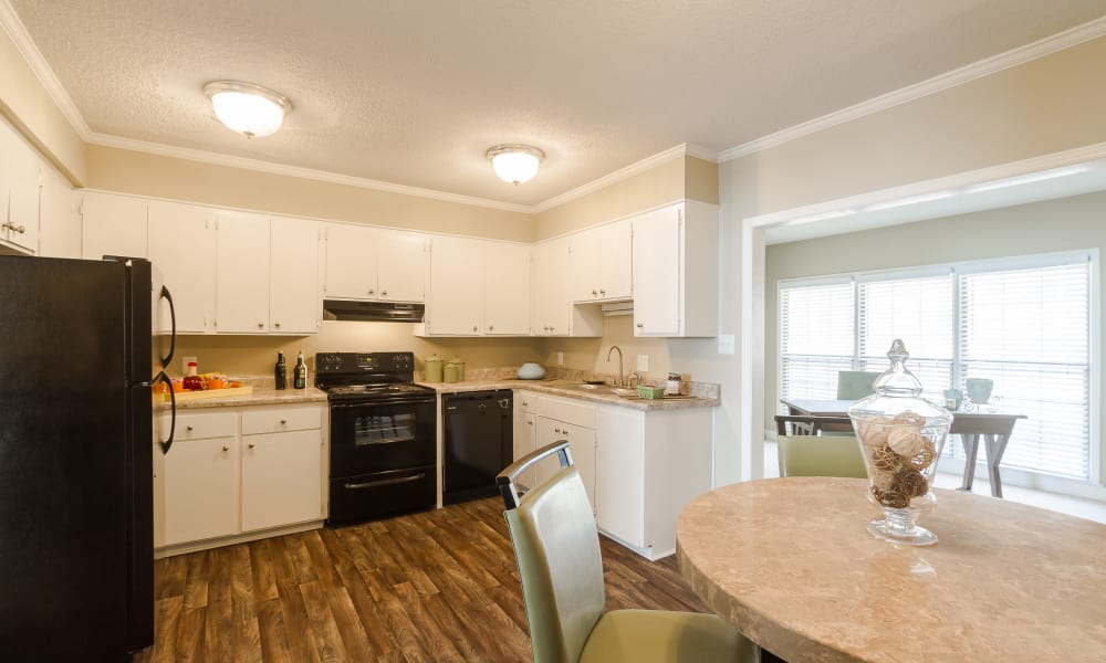 Dining area and modern kitchen at Dwell on Riverside in Macon, GA