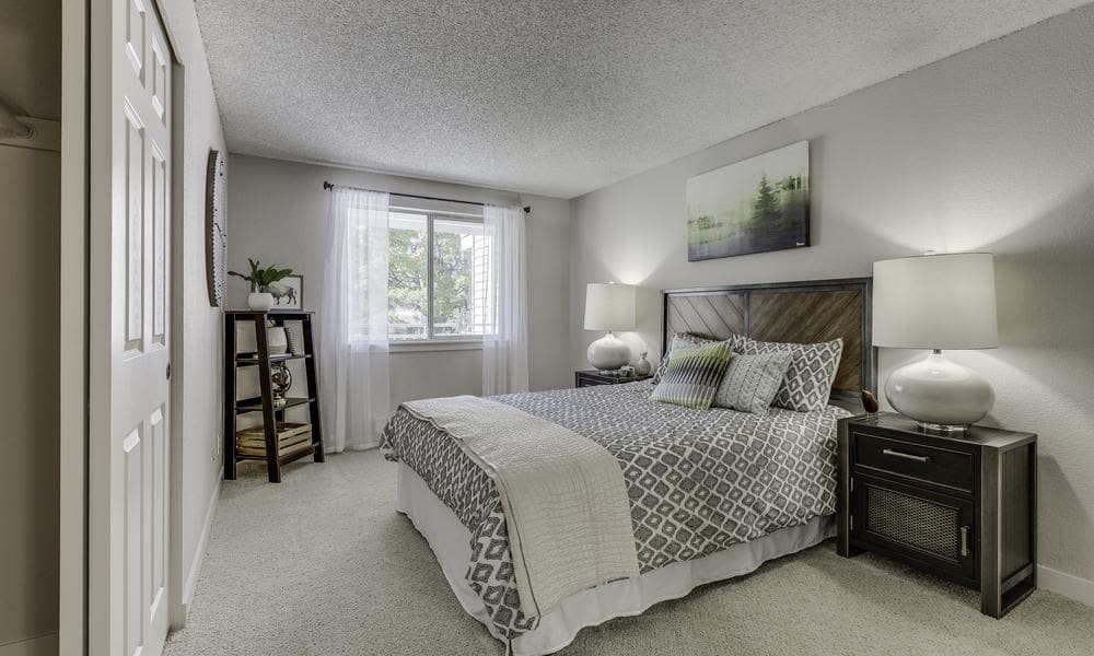 Model bedroom at Alaire Apartments in Renton