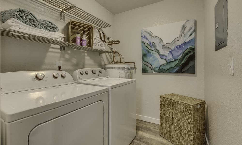 Model laundry room at Alaire Apartments in Renton