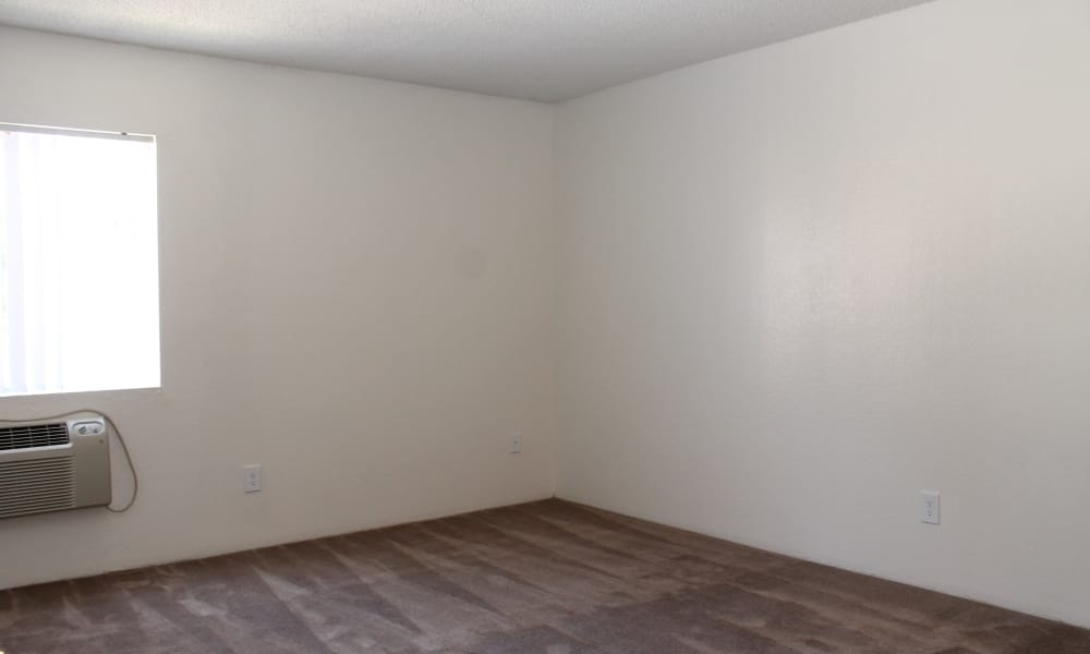Carpeted living space at apartments in West Covina, California