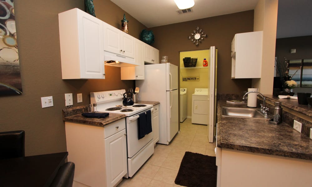 Kitchen and laundry room at Palms at Wyndtree