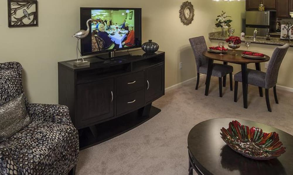 Enjoy cozy living space at Waltonwood University senior apartments