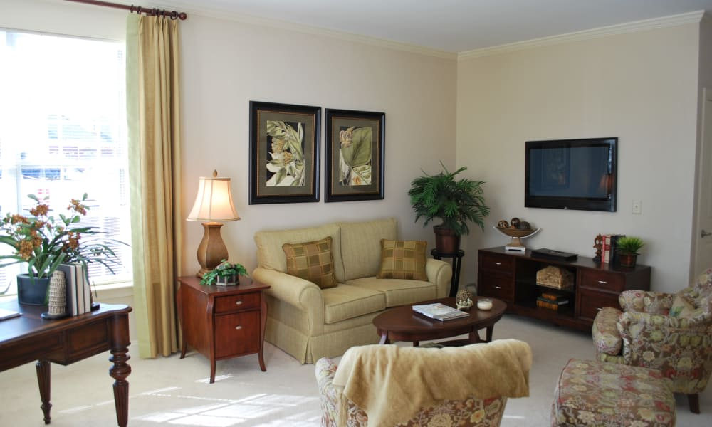 Apartment living room at Waltonwood Cary Parkway