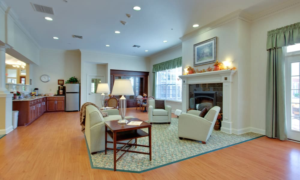 Activity center with fireplace at Waltonwood Cary Parkway