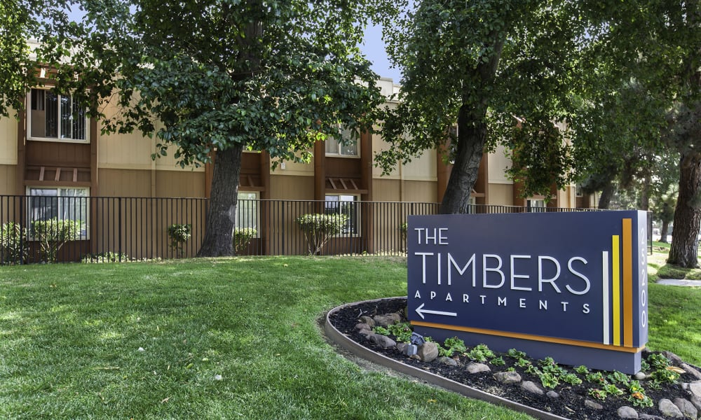 Entrance Sign at The Timbers Apartments in Hayward, CA