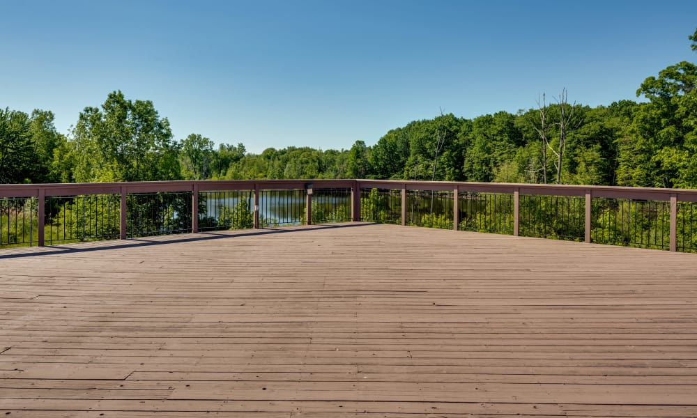 Enjoy our beautiful wood deck with view to the lake at Auburn Gate