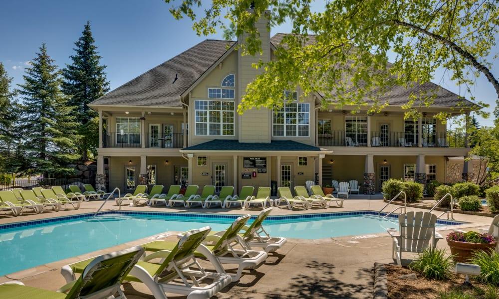 Swimming Pool With Chairs Around at Auburn Gate in Auburn Hills, MI