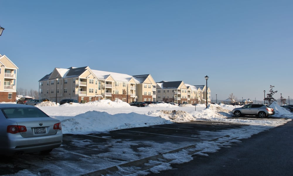 Apartments covered by snow at The Fairways at Timber Banks in Baldwinsville, NY