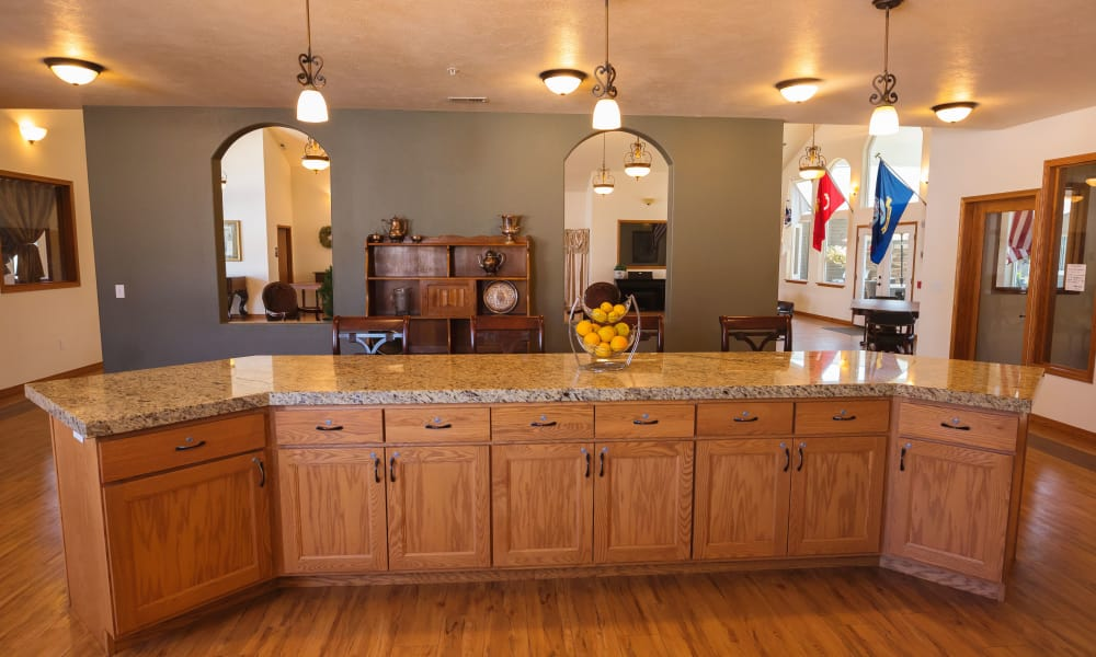 Kitchen with breakfast bar inside Generations Assisted Living