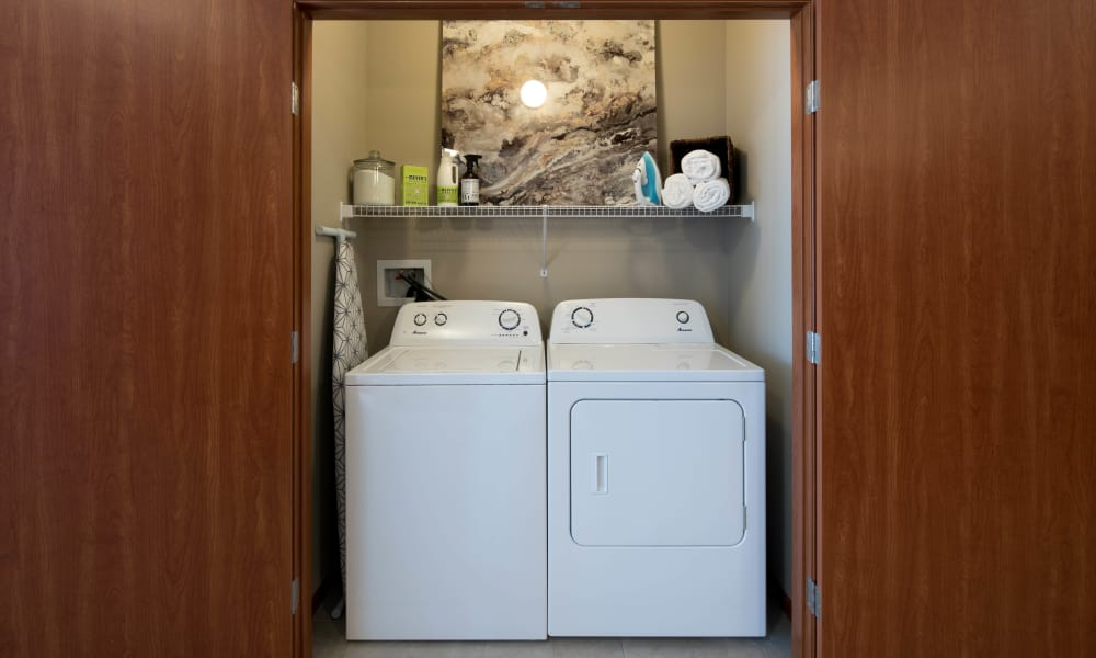 Laundry Room at Remington Cove Apartments in Apple Valley