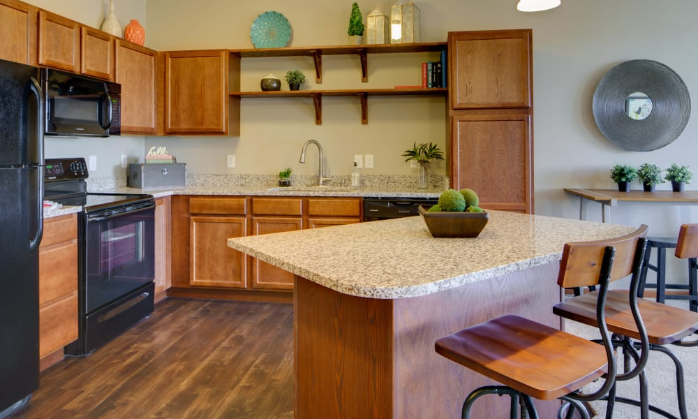 Kitchen island at Remington Cove Apartments in Apple Valley