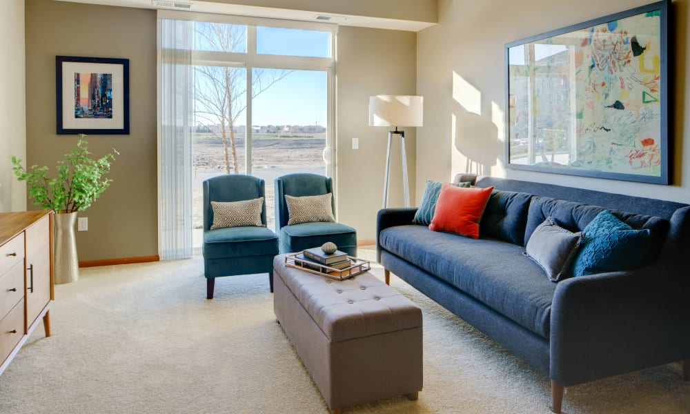 Bright living room area at Remington Cove Apartments in Apple Valley