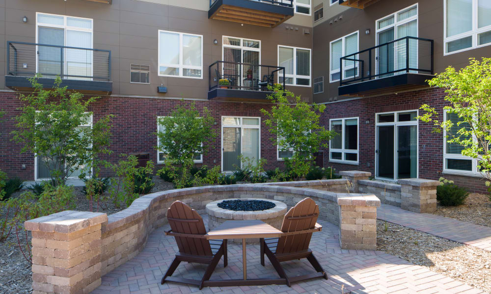 Courtyard Fire Pit seating at Remington Cove Apartments in Apple Valley