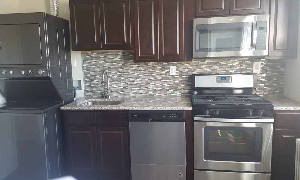 Harper House Apartment Homes offers a fully equipped kitchen in Highland Park, NJ