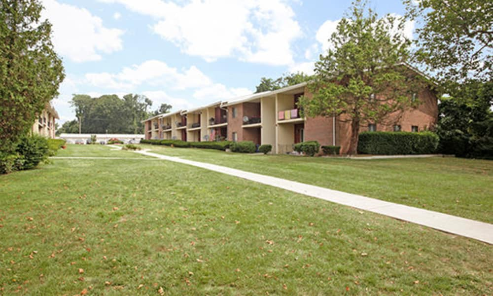 Enjoy apartments with walking paths across well maintained lawn at Edgewater Gardens Apartment Homes