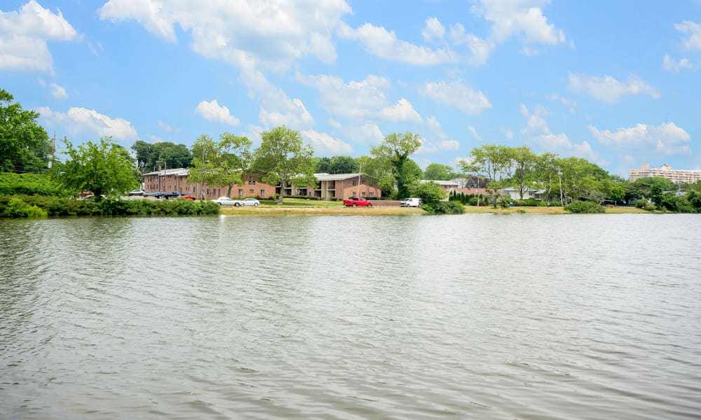 Exterior view from lake at Edgewater Gardens Apartment Homes in Long Branch, NJ