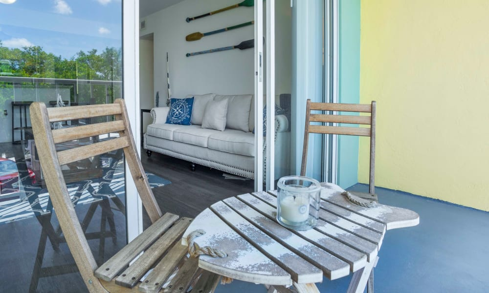 Balcony seating at Ocean Walk Apartments in Key West