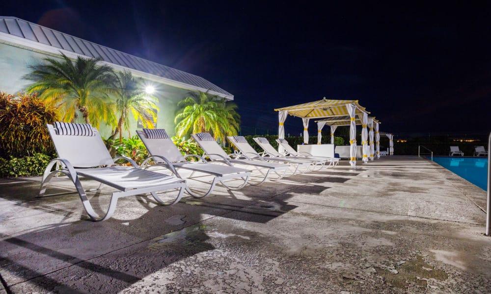 Night time pool shot of Ocean Walk Apartments in Key West