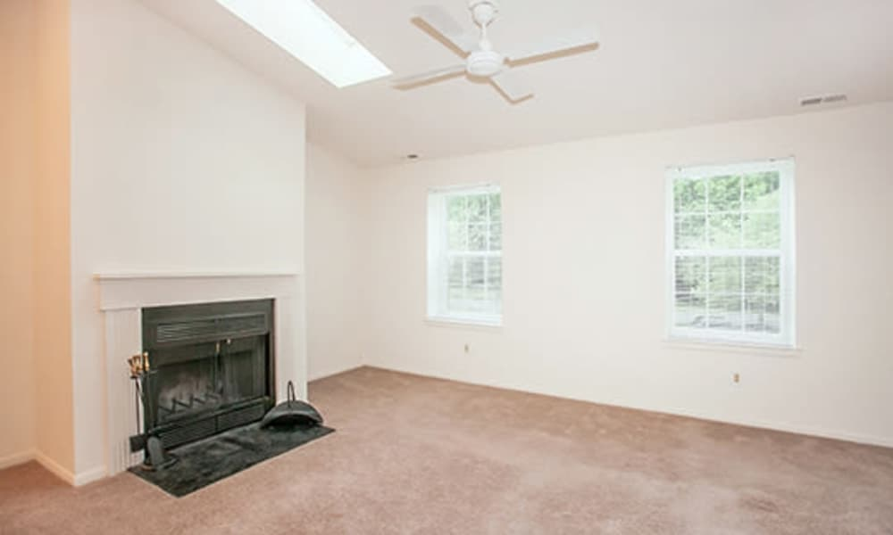 Tory Estates Apartment Homes offers a living room with chimney in Clementon, NJ
