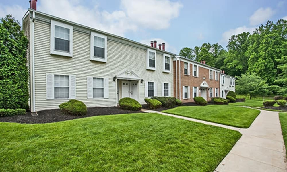 Patio with well maintained lawn at Tory Estates Apartment Homes in Clementon, NJ