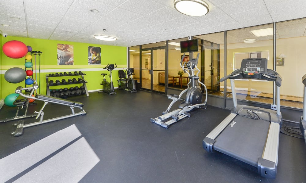 Fully equipped fitness center at Lexington House Apartment Homes
