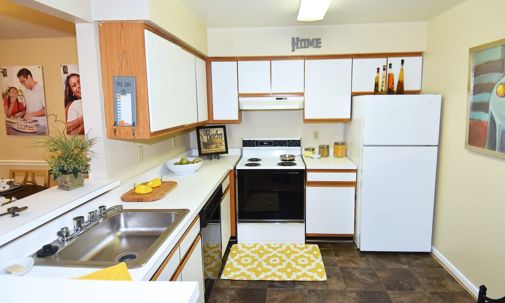 Northampton Apartment Homes offers a kitchen with breakfast bar in Largo, MD