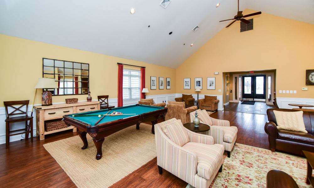 Living room with billiards table at Bishop's View Apartments & Townhomes in Cherry Hill, NJ