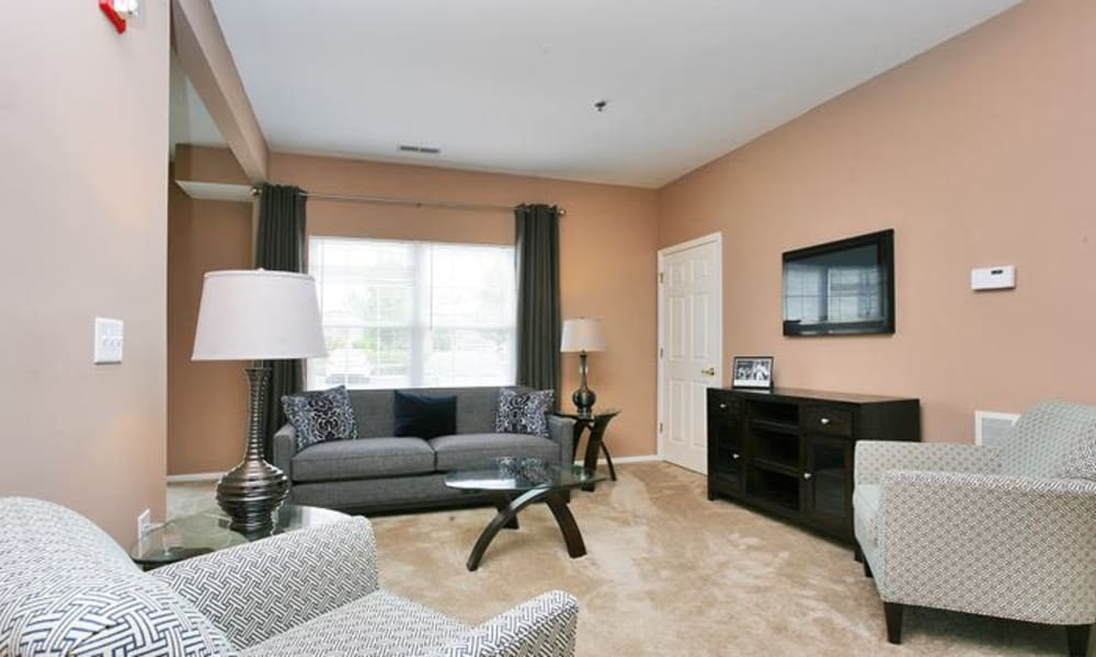 Woodview at Marlton Apartment Homes offers a living room in Marlton, NJ