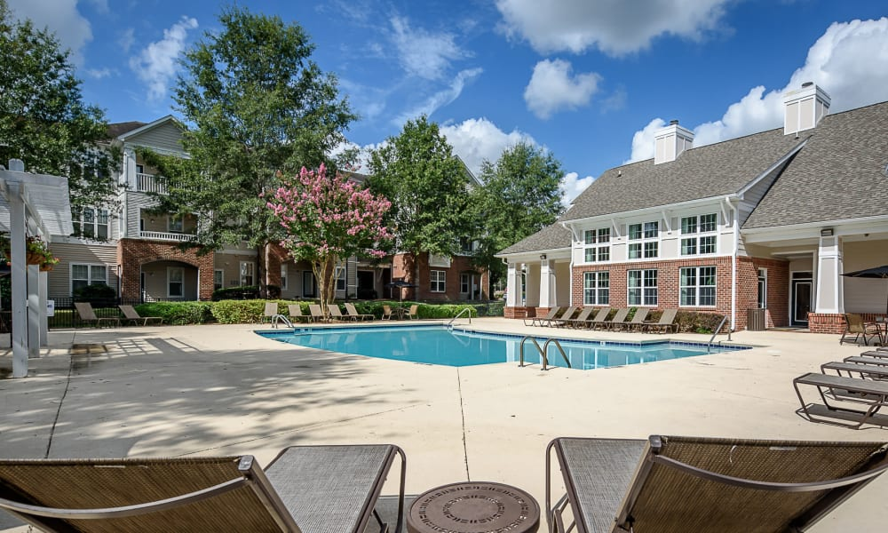 Spacious pool deck at Falls Creek Apartments & Townhomes