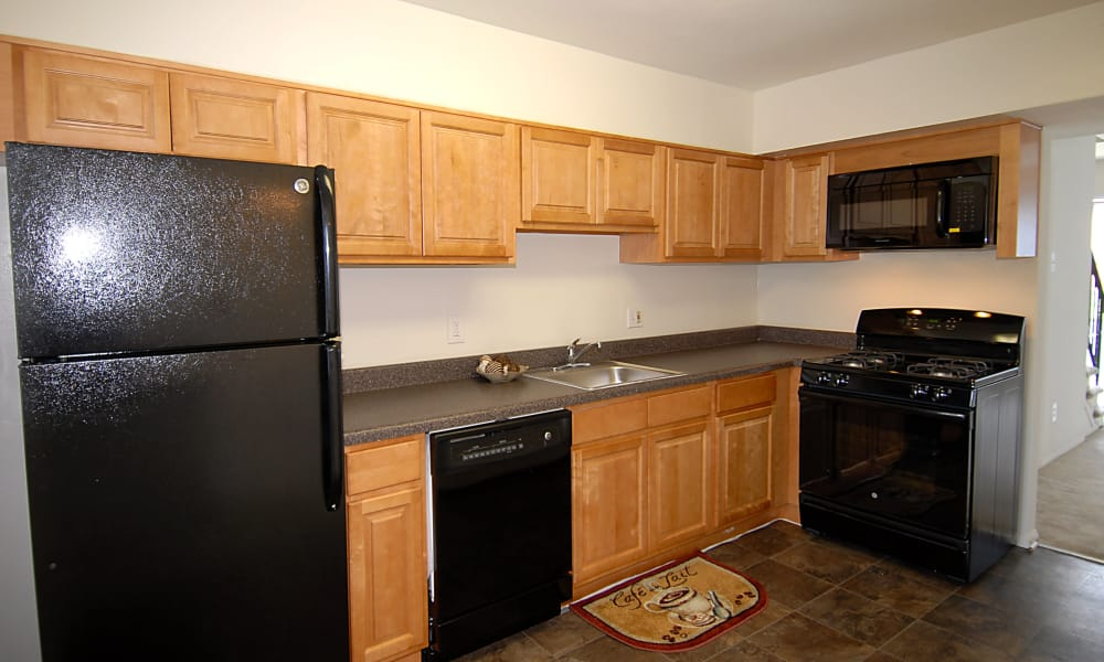 Kitchen at Cedar Gardens and Towers Apartments & Townhomes in Windsor Mill, MD