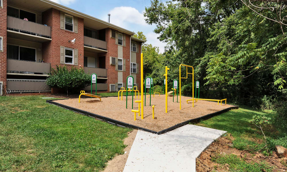 Outdoors health and fitness equipment at Cedar Gardens and Towers Apartments & Townhomes in Windsor Mill, MD