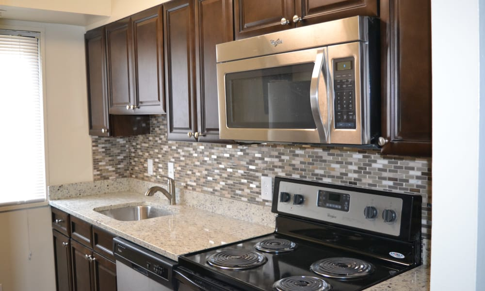 Villages at Montpelier Apartment Homes offers a kitchen in Laurel, MD