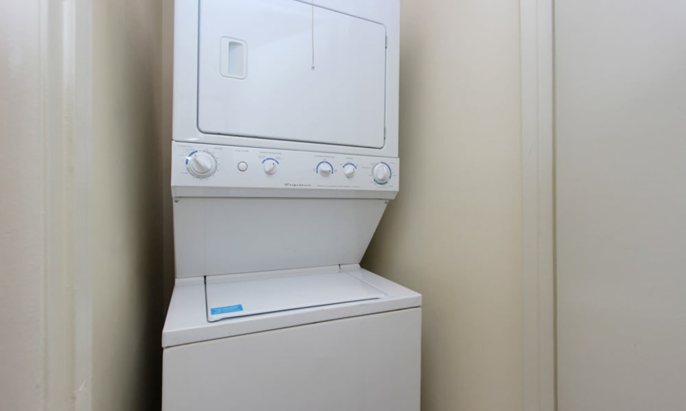 Washer and dryer machine at Villages at Montpelier Apartment Homes in Laurel, MD