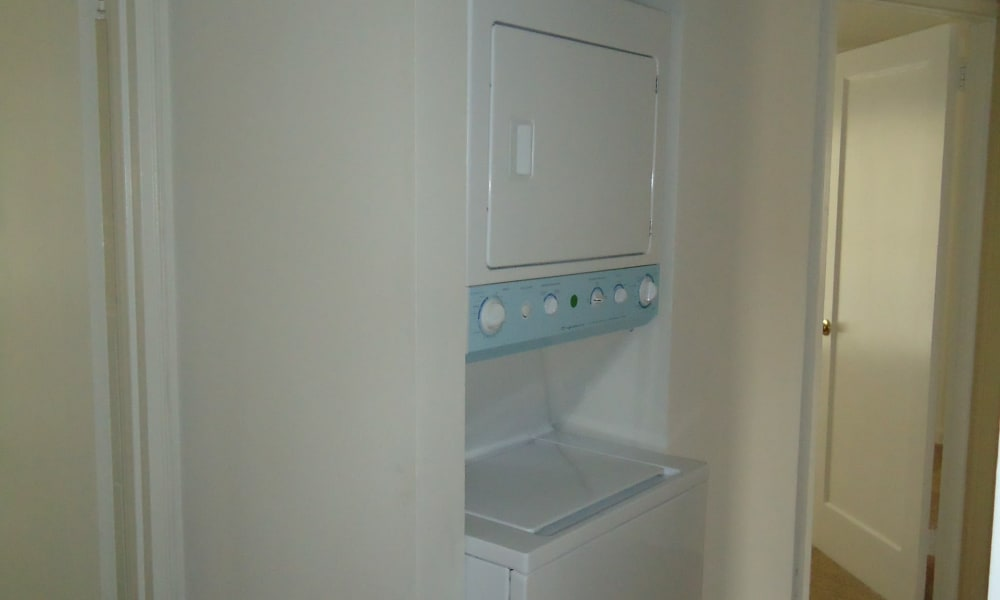 Washer and dryer machine at General Greene Village Apartment Homes in Springfield, NJ