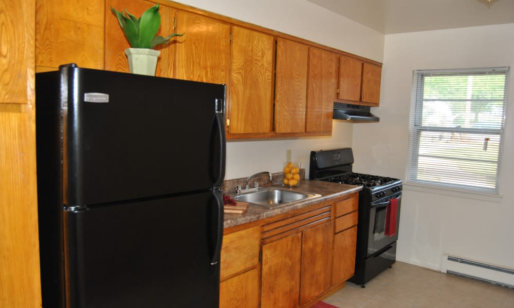 Village Green Apartment Homes offers a modern kitchen in South River, NJ