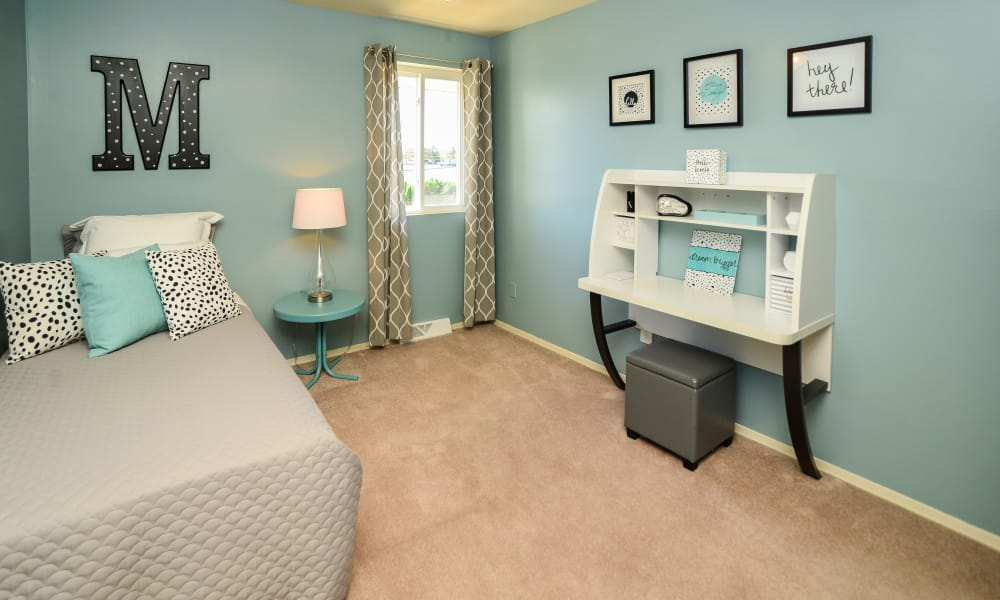 Model bedroom at Greentree Village Townhomes in Lebanon, PA with a teal theme