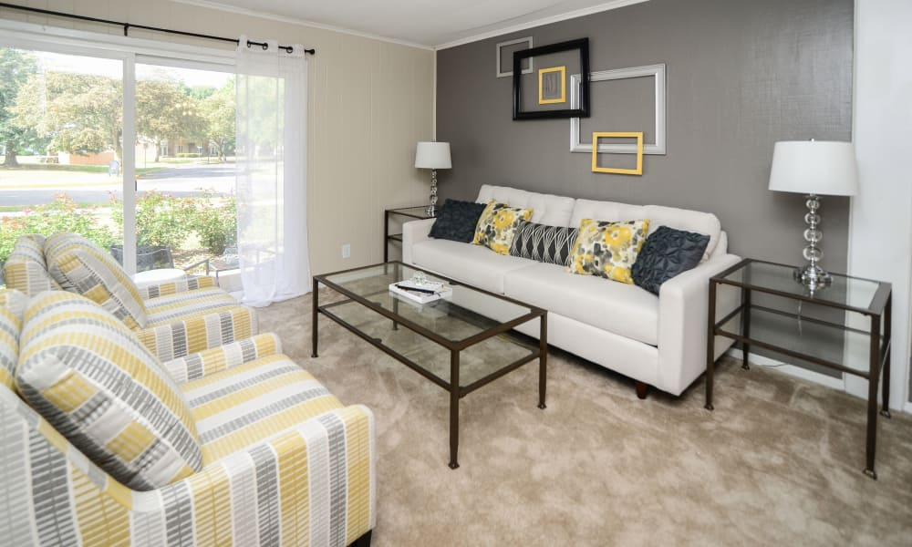 Oxford Manor Apartments & Townhomes offers a naturally well-lit living room in Mechanicsburg, PA