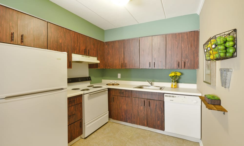 Kitchen featuring wooden cabinetry at William Penn Village Apartment Homes in New Castle, Delaware