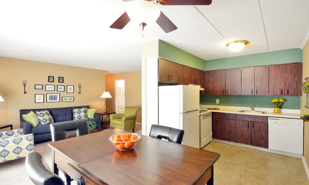 Sunlit dining room area at William Penn Village Apartment Homes in New Castle, Delaware