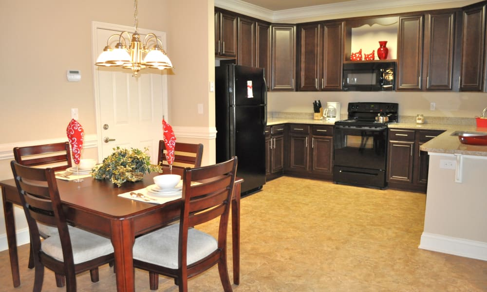 Kitchen and dining area at Delaney Apartment Homes in Concord