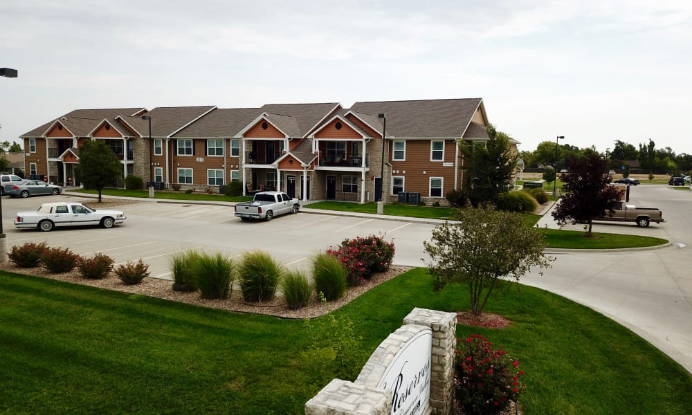 Front view of apartments and parking at The Reserves at Cimarron Valley