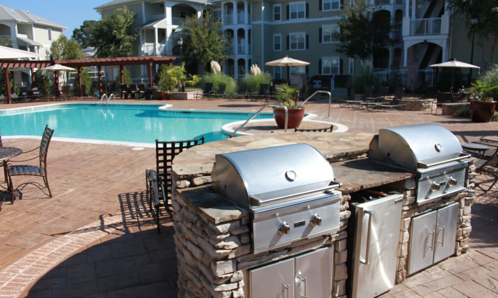 BBQs close to the pool at Delaney Apartment Homes in Concord