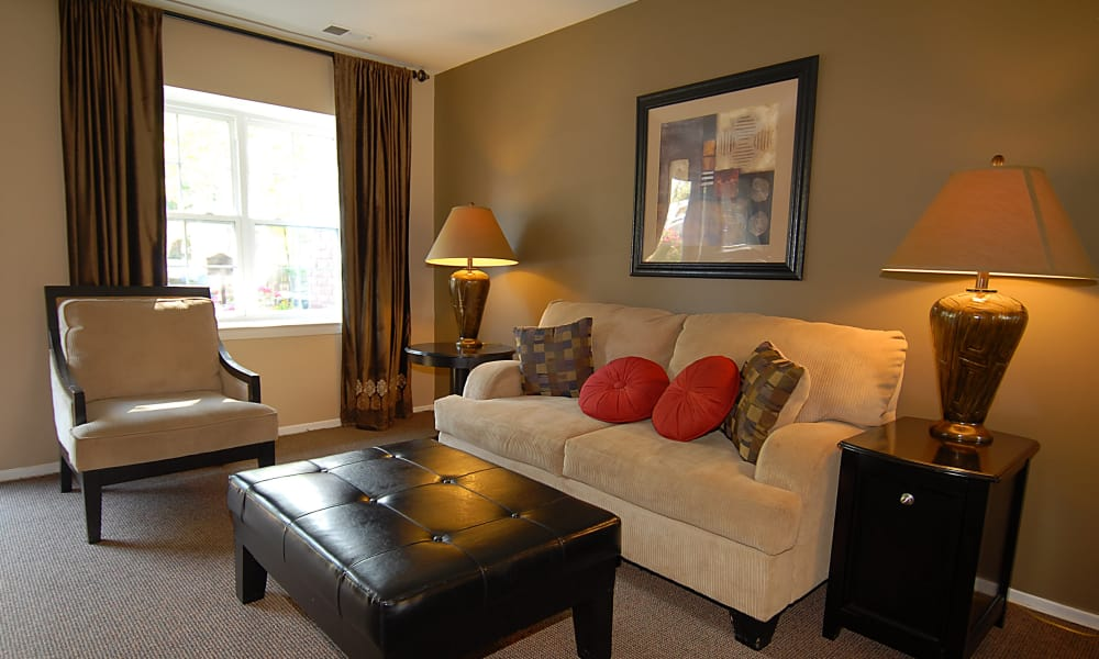 Beautifully decorated model living room at Arbors at Edenbridge Apartments & Townhomes in Parkville, MD